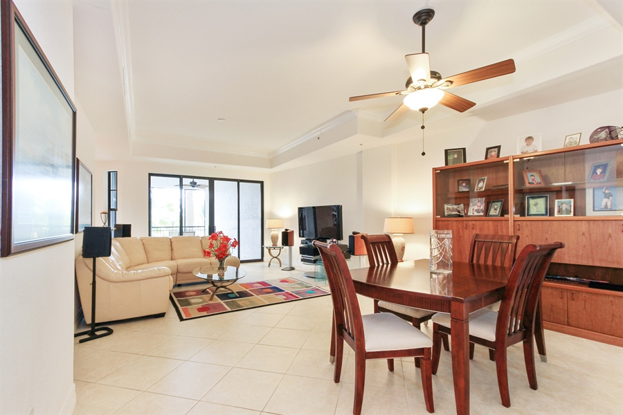 Real Estate Photography - 10733 Mirasol Dr. #307, Miromar Lakes, FL, 33913 - Open plan with tray ceilings & crown molding.