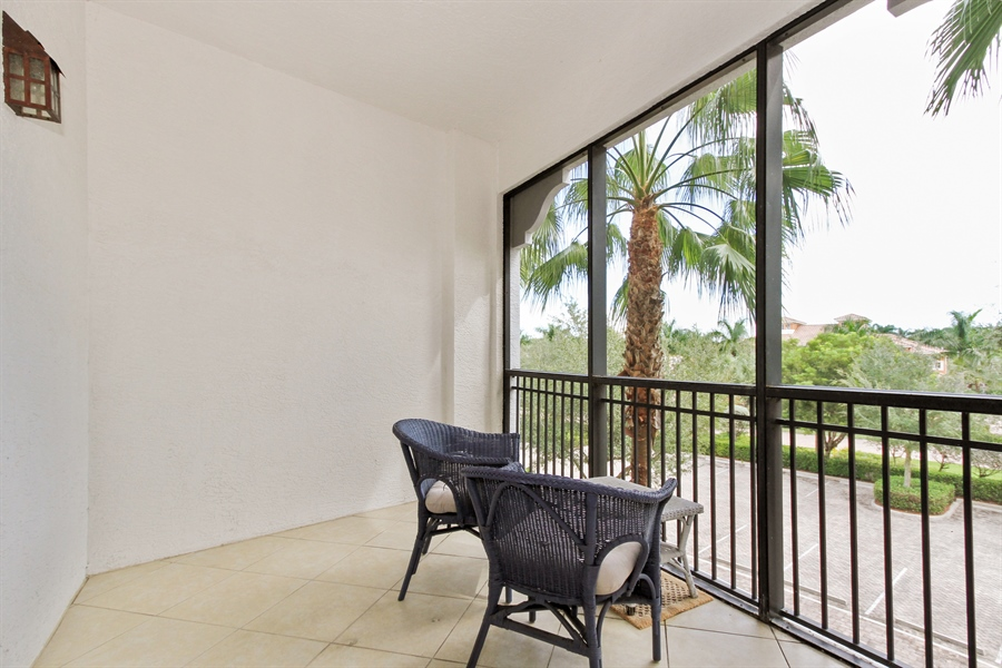 Real Estate Photography - 10733 Mirasol Dr. #307, Miromar Lakes, FL, 33913 - Screened Private Balcony off of Master Bedroom