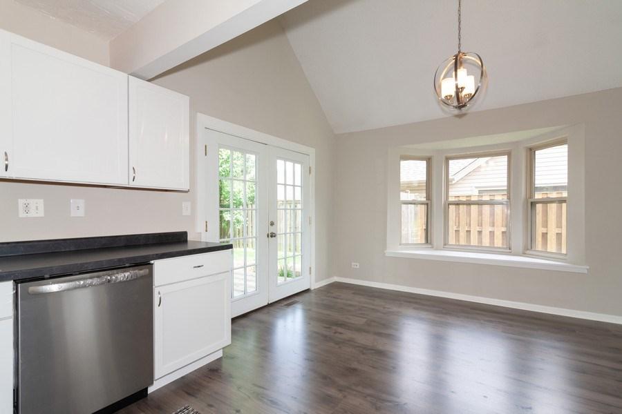 Real Estate Photography - 850 Camden, Aurora, IL, 60504 - Kitchen / Dining Room