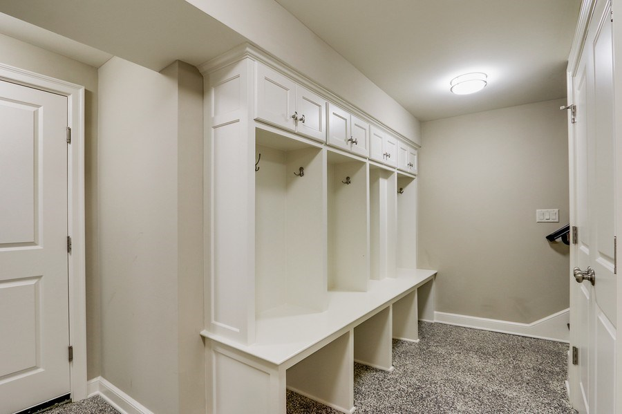 Real Estate Photography - 5651 High Dr, Mission Hills, KS, 66208 - Mudrm Cubbies in Lower Level