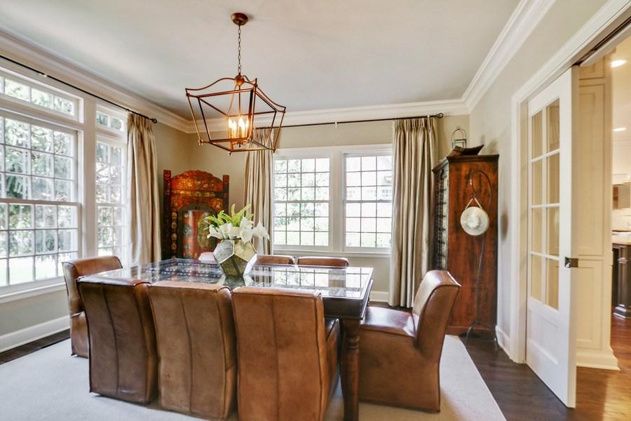 Real Estate Photography - 5651 High Dr, Mission Hills, KS, 66208 - Formal Dining Room with Glass Pocket Doors