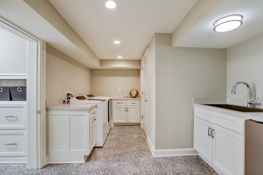 Real Estate Photography - 5651 High Dr, Mission Hills, KS, 66208 - Second Laundry Room in Lower Level