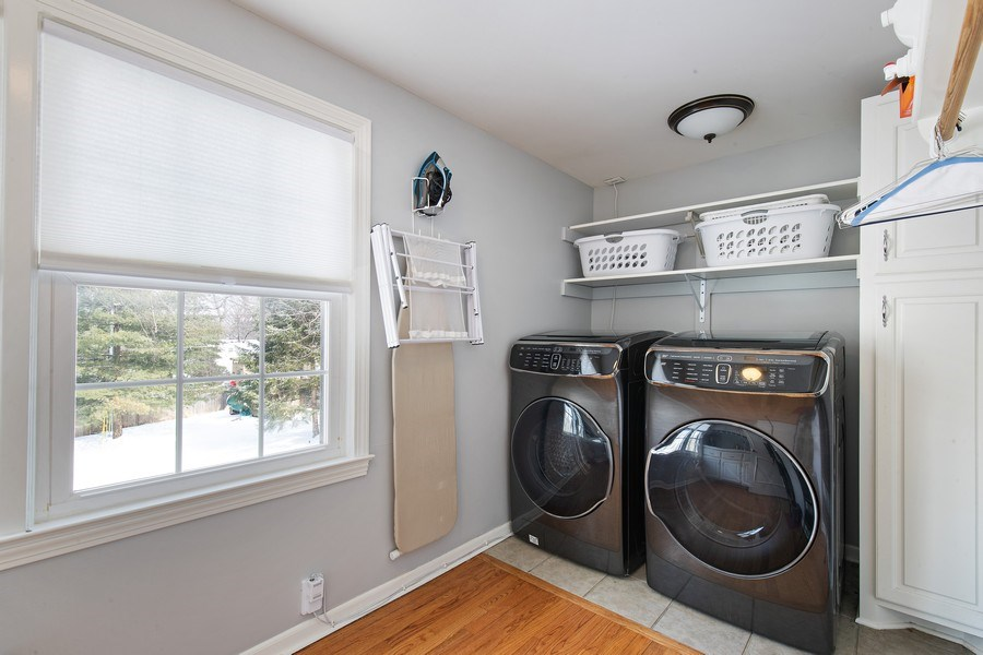 Real Estate Photography - 6108 W 61st Terrace, Mission, KS, 66202 - 2nd floor laundry room with sink & storage