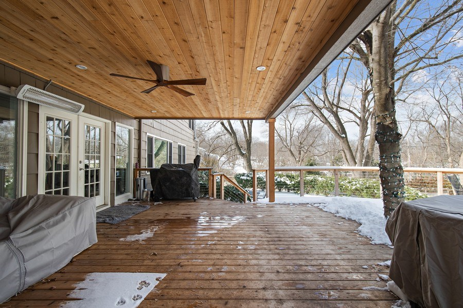 Real Estate Photography - 6108 W 61st Terrace, Mission, KS, 66202 - Spacious partially-covered deck off kitchen