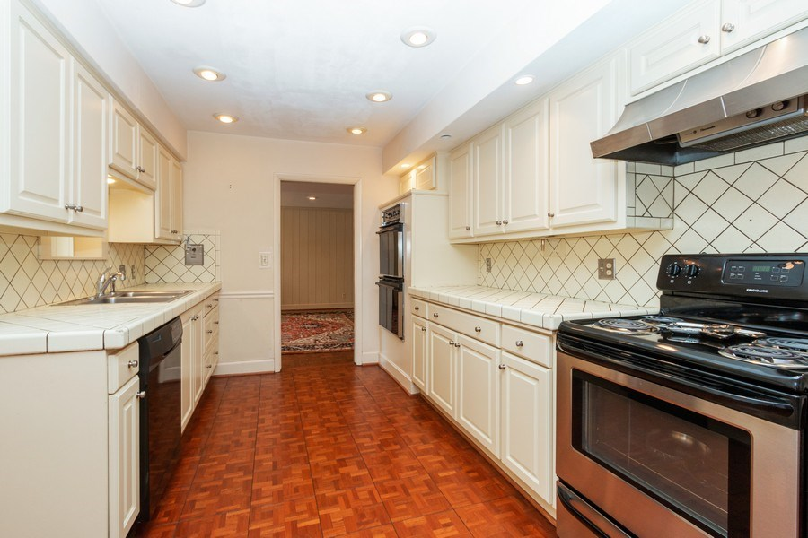 Real Estate Photography - 8321 Roe Ave, Prairie Village, KS, 66207 - Kitchen