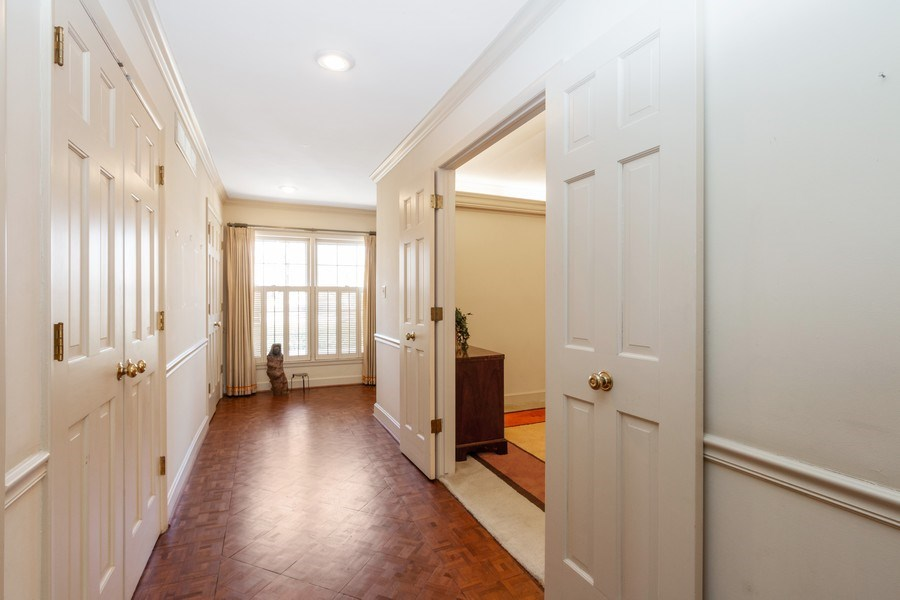 Real Estate Photography - 8321 Roe Ave, Prairie Village, KS, 66207 - Hallway