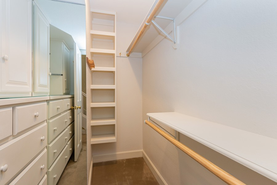 Real Estate Photography - 1105 West 47th Street B, Kansas City, MO, 64112 - Master Bedroom Closet