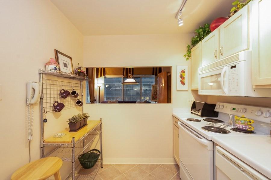 Real Estate Photography - 211 E Ohio, Unit 505, Chicago, IL, 60611 - Kitchen
