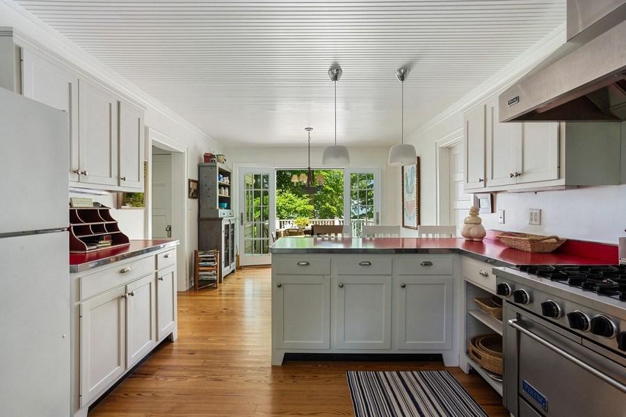 Real Estate Photography - 15120 Lakeshore Road, Lakeside, MI, 49116 - Kitchen to Deck