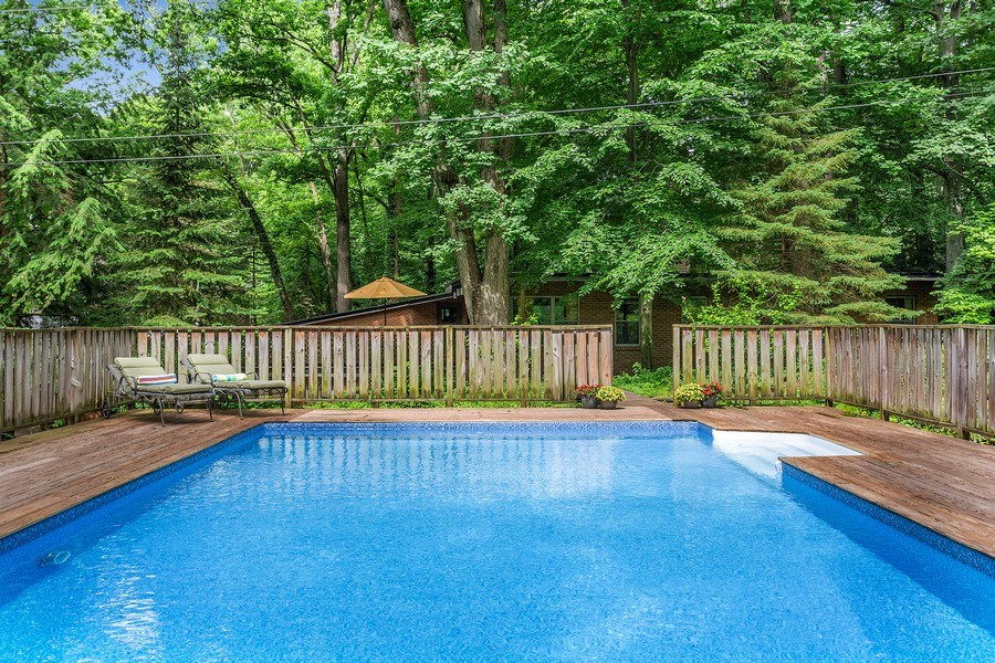 Real Estate Photography - 9715 Evergreen Drive, Bridgman, MI, 49106 - Rear of Home From Pool