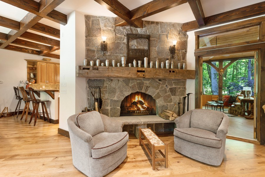 Real Estate Photography - 7020 Youngren Rd, Three Oaks, MI, 49128 - Fireplace  - Living Room to Dining to Screened Roo