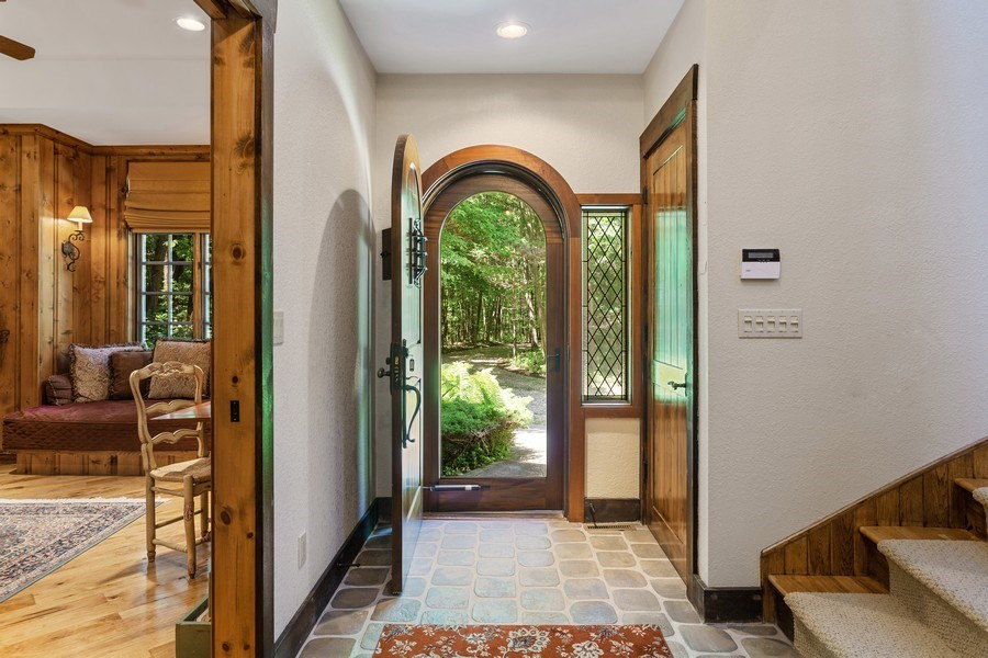 Real Estate Photography - 7020 Youngren Rd, Three Oaks, MI, 49128 - Front Entry Foyer & Library Peek