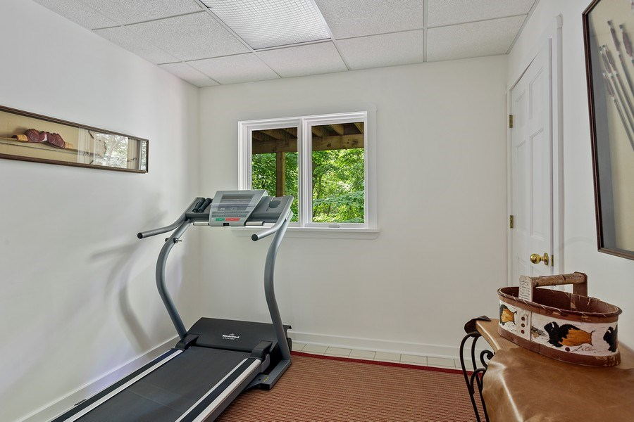 Real Estate Photography - 14458 Ridgeview Drive, New Buffalo, MI, 49117 - 4th Bedroom as Fitness Room