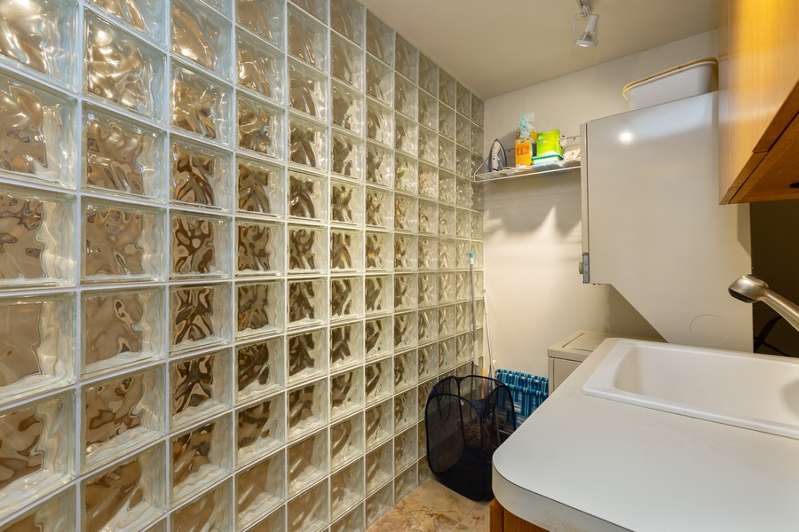 Real Estate Photography - 110 E. Delaware Place, 1804, Chicago, IL, 60611 - Laundry Room