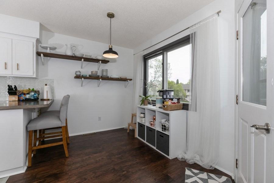 Real Estate Photography - 1503 128th Lane NE, Blaine, MN, 55449 - Dining Area 2