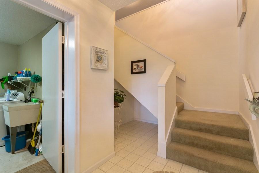 Real Estate Photography - 17109 WATERBEND DR 222, JUPITER, FL, 33477 - FRONT ENTRANCE AND GARAGE ENTRANCE
