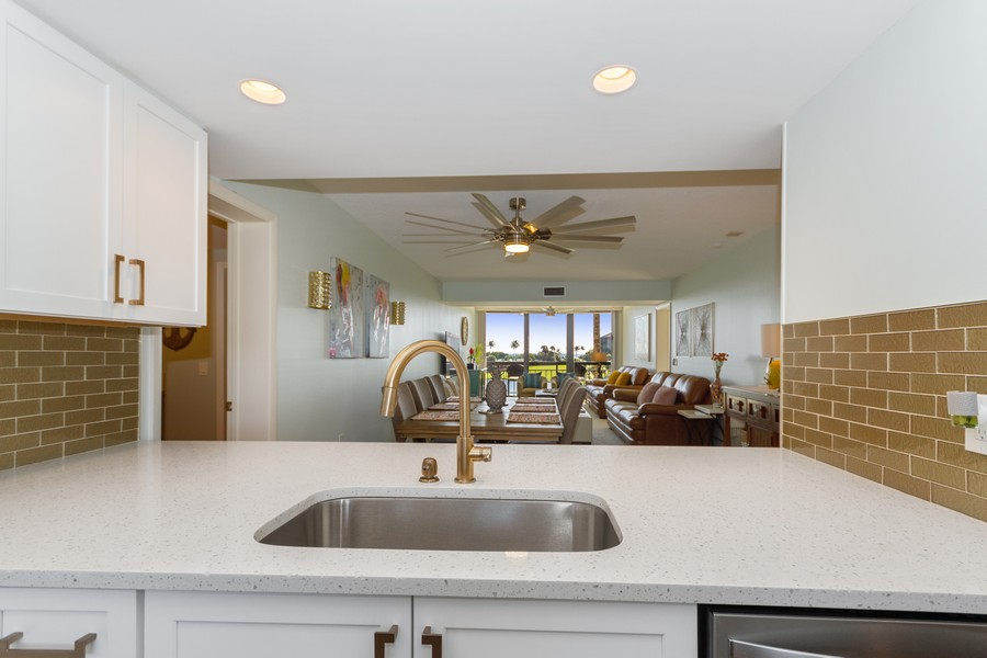 Real Estate Photography - 301 S. SEAS DR., APT. 302, JUPITER, FL, 33477 - QUARTZ COUNTER TOP STAINLESS STEEL SINK