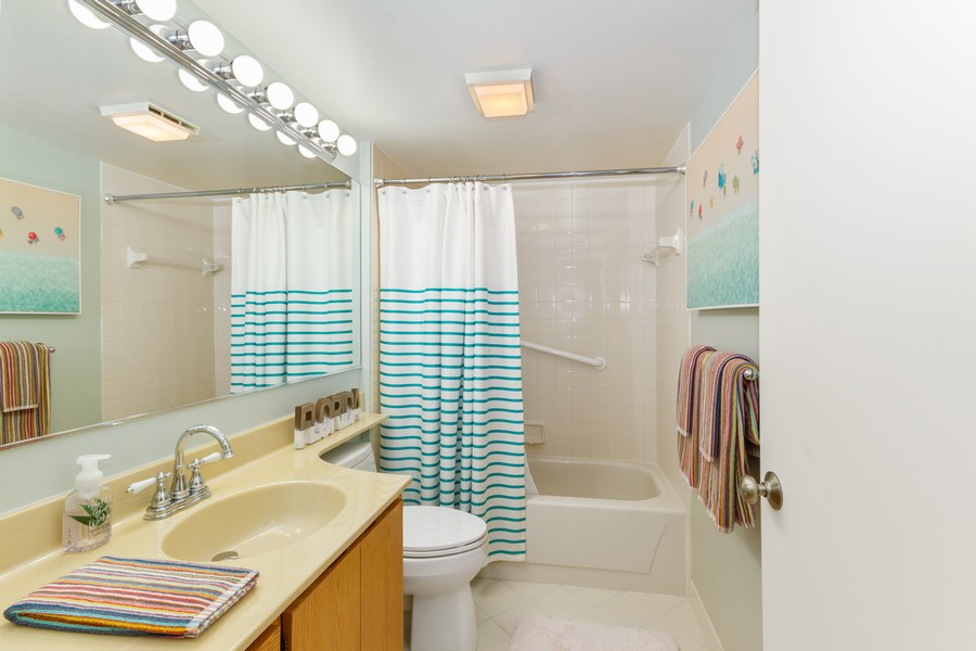 Real Estate Photography - 301 S. SEAS DR., APT. 302, JUPITER, FL, 33477 - GUEST BATHROOM UP-DATED WITH FIXTURES, COMMODE AND
