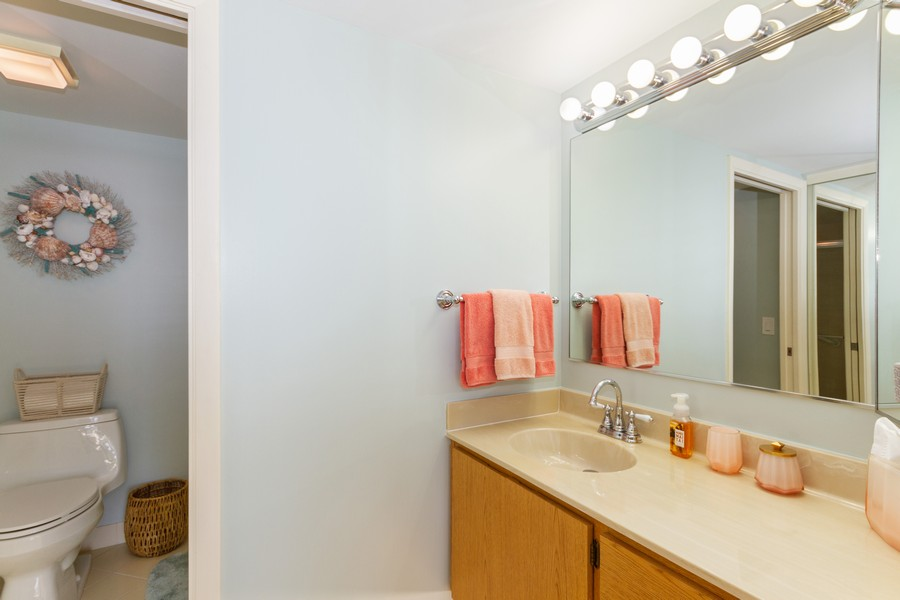 Real Estate Photography - 301 S. SEAS DR., APT. 302, JUPITER, FL, 33477 - MASTERBEDROOM UPDATED FIXTURES, COMMODE AND LIGHTI