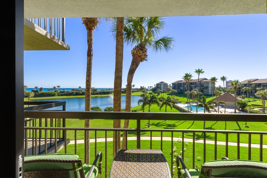 Real Estate Photography - 301 S. SEAS DR., APT. 302, JUPITER, FL, 33477 - MASTER BEDROOM BALCONY VIEW
