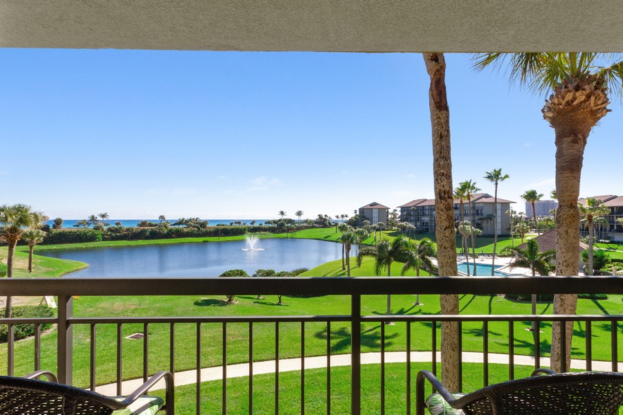 Real Estate Photography - 301 S. SEAS DR., APT. 302, JUPITER, FL, 33477 - LIVING ROOM BALCONY VIEW