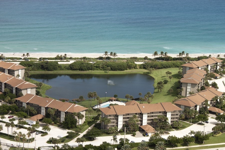 Real Estate Photography - 301 S. SEAS DR., APT. 302, JUPITER, FL, 33477 - AERIAL VIEW OF THE OCEAN AT THE BLUFFS SOUTH