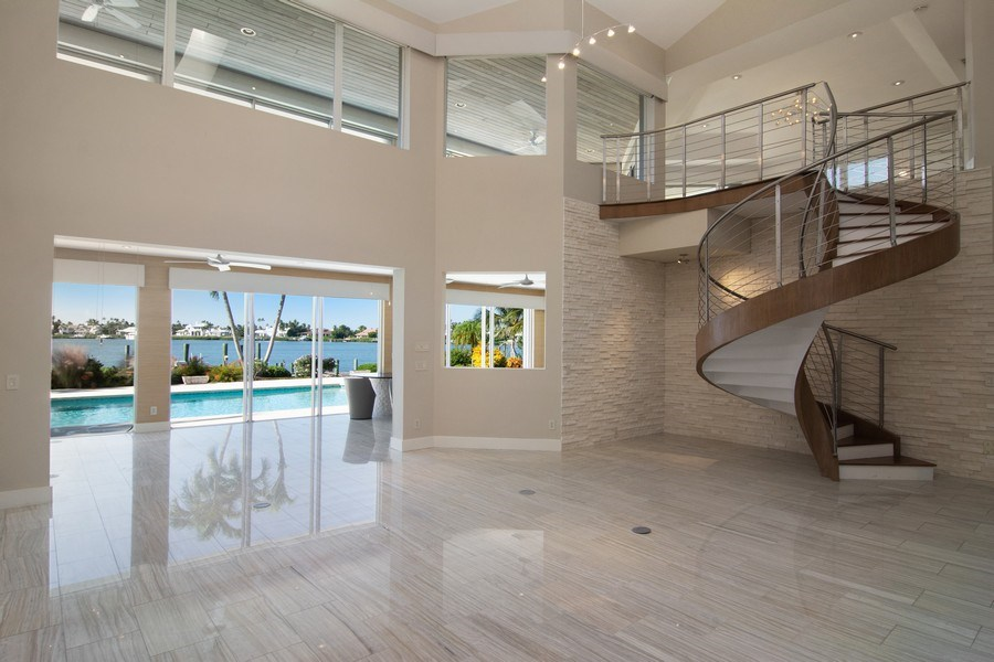 Real Estate Photography - 6900 SE Harbor Circle, Stuart, FL, 34996 - Living Room with Staircase