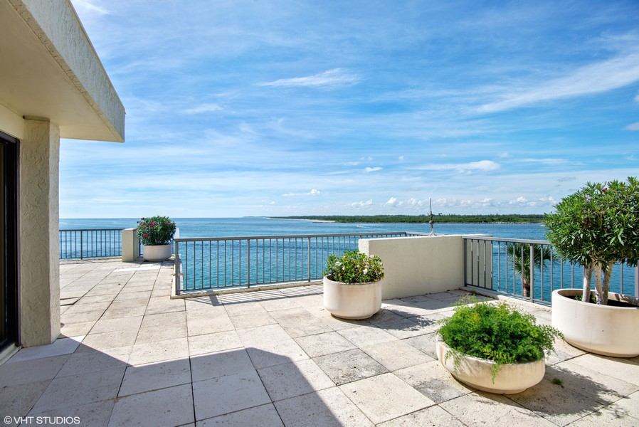 Real Estate Photography - 2824 SE Dune Drive, 2401, Stuart, FL, 34996 - Terrace View out St. Lucie Inlet