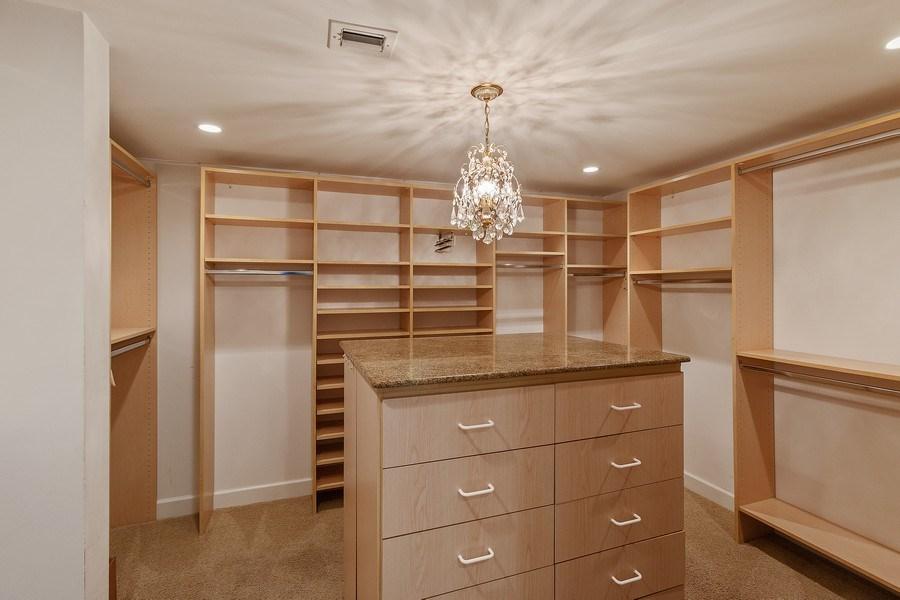 Real Estate Photography - 2802 SE Dune Drive, #1312, Stuart, FL, 34996 - Master Bedroom Closet