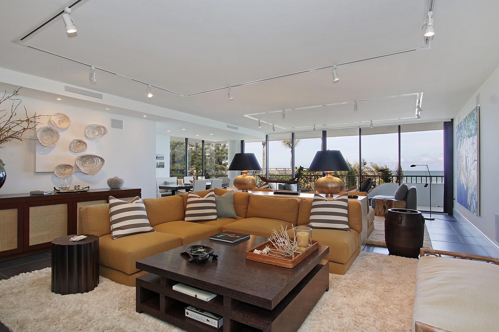 Real Estate Photography - 2001 SE Sailfish Point Blvd, Unit 318, Stuart, FL, 34996 - Living Room
