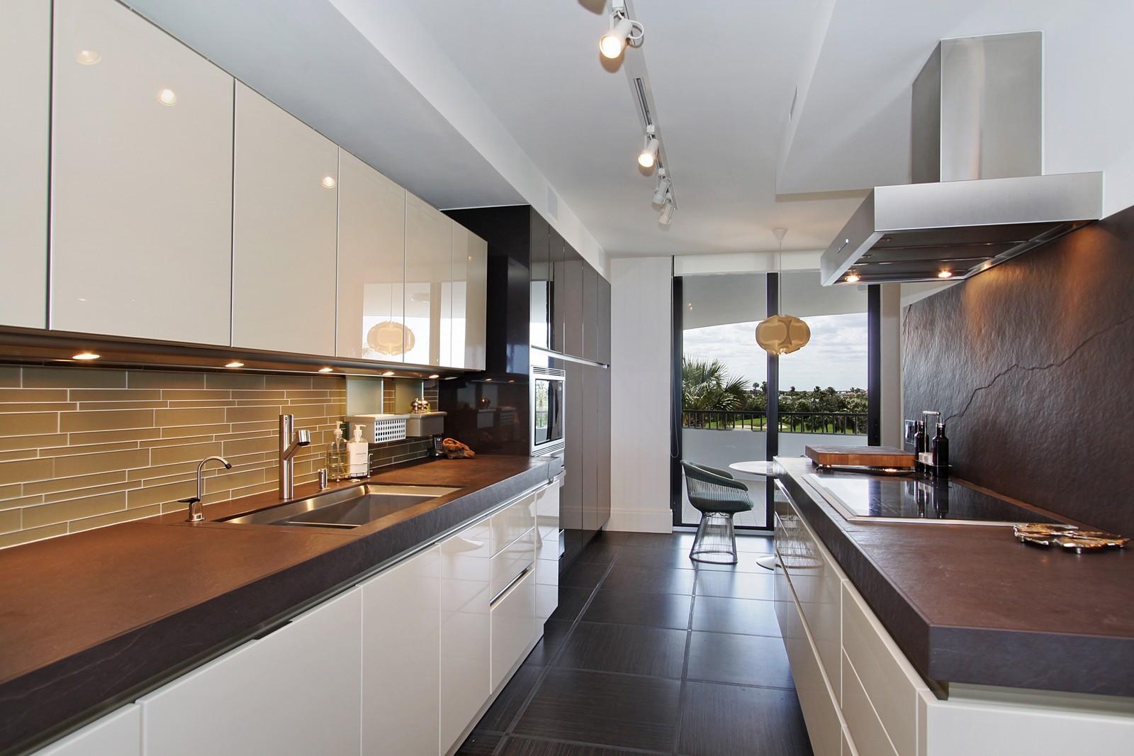 Real Estate Photography - 2001 SE Sailfish Point Blvd, Unit 318, Stuart, FL, 34996 - Kitchen