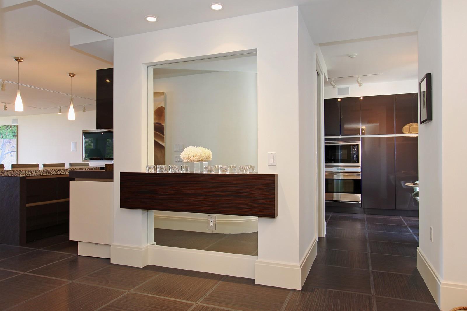 Real Estate Photography - 2001 SE Sailfish Point Blvd, Unit 318, Stuart, FL, 34996 - Foyer