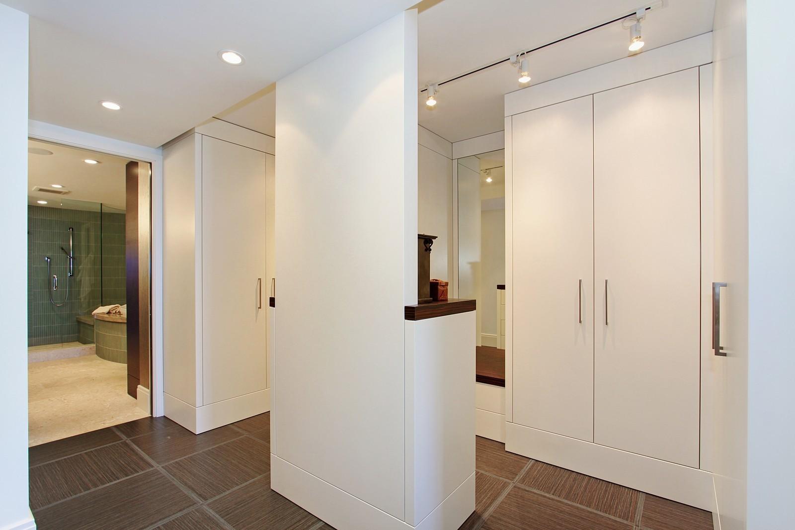 Real Estate Photography - 2001 SE Sailfish Point Blvd, Unit 318, Stuart, FL, 34996 - Master Bedroom Closet