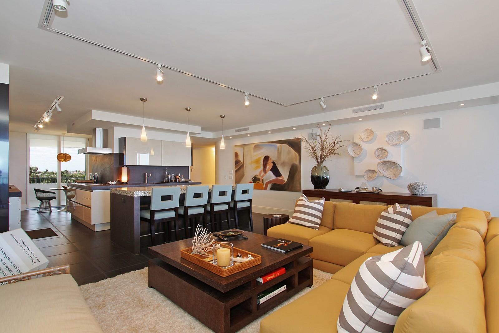 Real Estate Photography - 2001 SE Sailfish Point Blvd, Unit 318, Stuart, FL, 34996 - Kitchen / Living Room