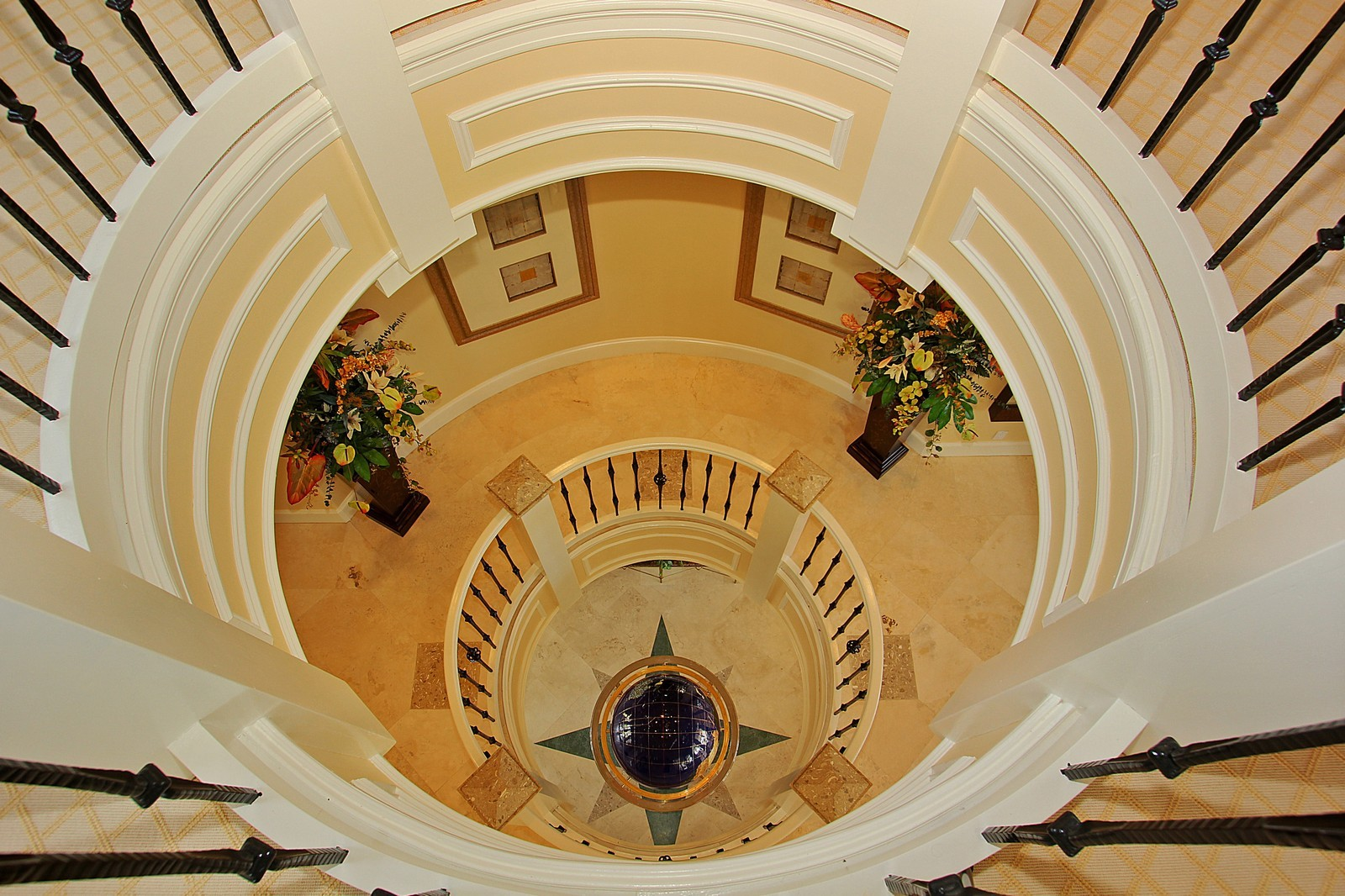 Real Estate Photography - 3047 SE Island Point Lane, Stuart, FL, 34996 - Rotunda looking down to Foyer