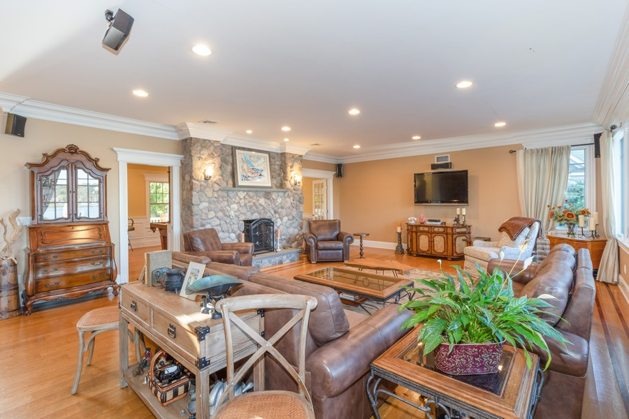 Real Estate Photography - 28 Sea Spray Dr, Centerport, NY, 11743 - Great Room w/ Fireplace and Water View