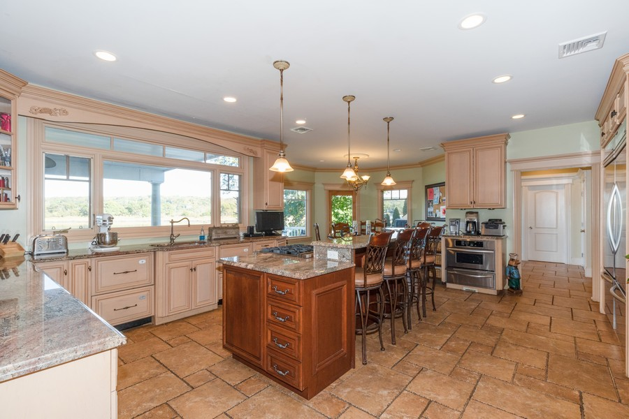 Real Estate Photography - 28 Sea Spray Dr, Centerport, NY, 11743 - Kitchen Looking  Into Breakfast Nook