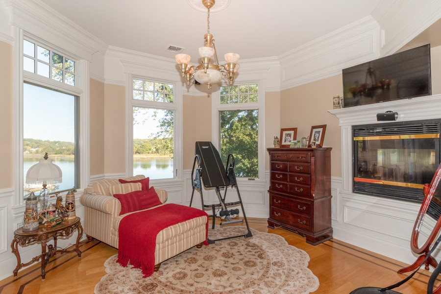 Real Estate Photography - 28 Sea Spray Dr, Centerport, NY, 11743 - Master Reading Nook w/ Fireplace