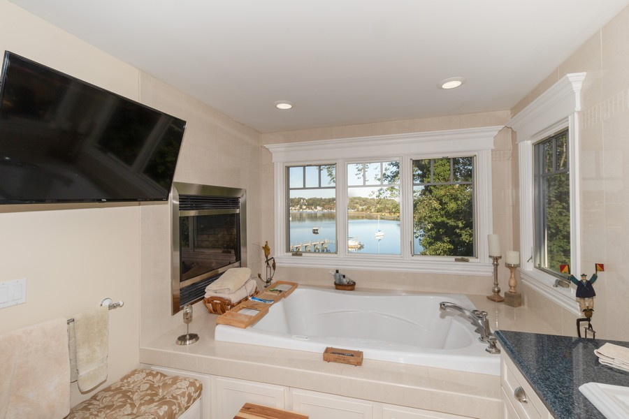 Real Estate Photography - 28 Sea Spray Dr, Centerport, NY, 11743 - Spa Master Tub w/ Fireplace and Water View