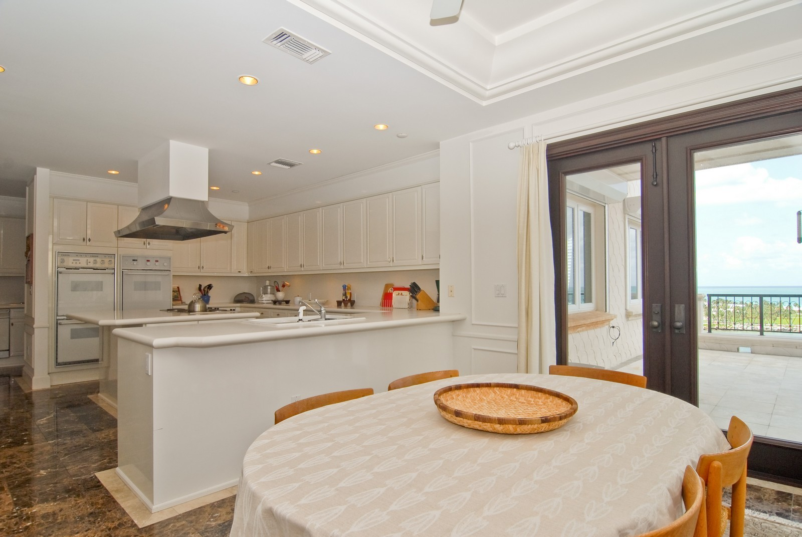 Real Estate Photography - 7281 Fisher Island Drive, Fisher Island, FL, 33109 - Kitchen / Breakfast Room