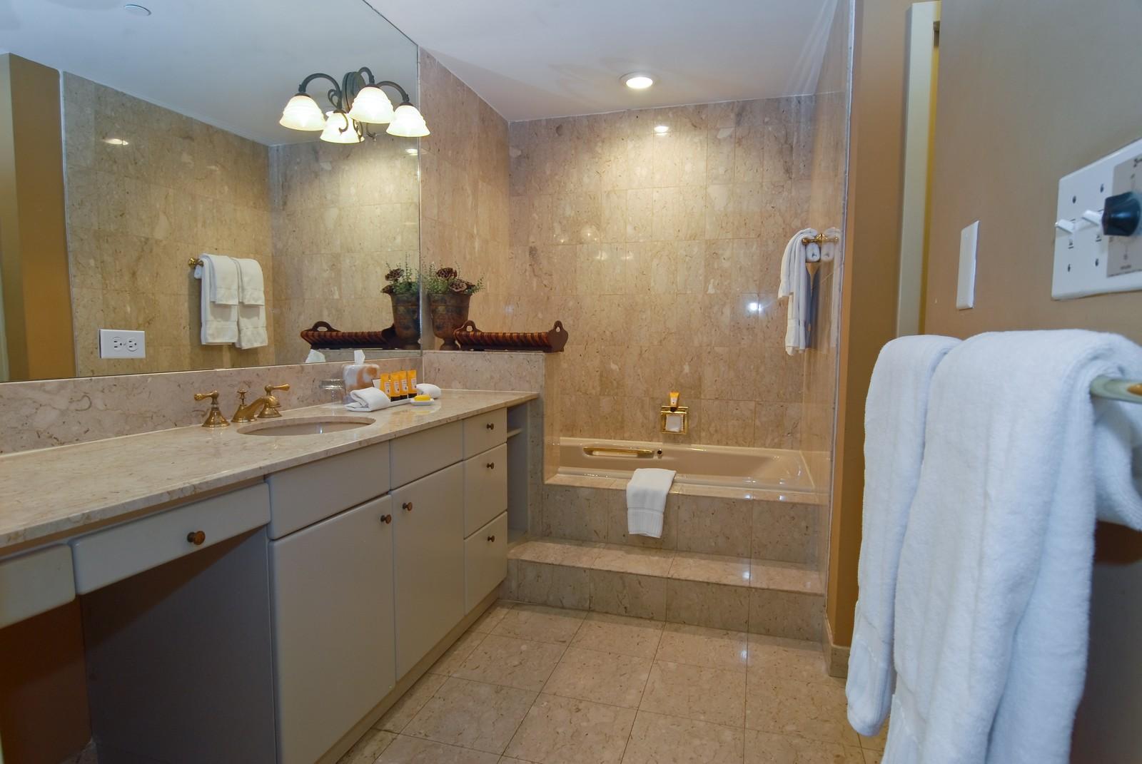 Real Estate Photography - 19124 Fisher Island Drive, Fisher Island, FL, 33109 - Master Bathroom