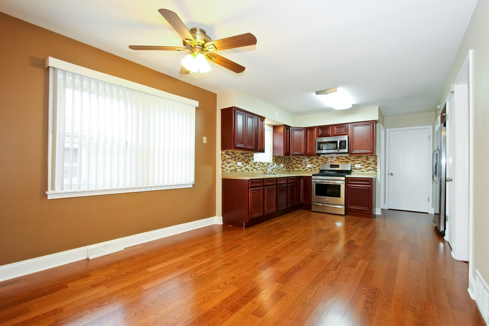 Real Estate Photography - 1025 E 156th St, Dolton, IL, 60419 - Kitchen / Dining Room