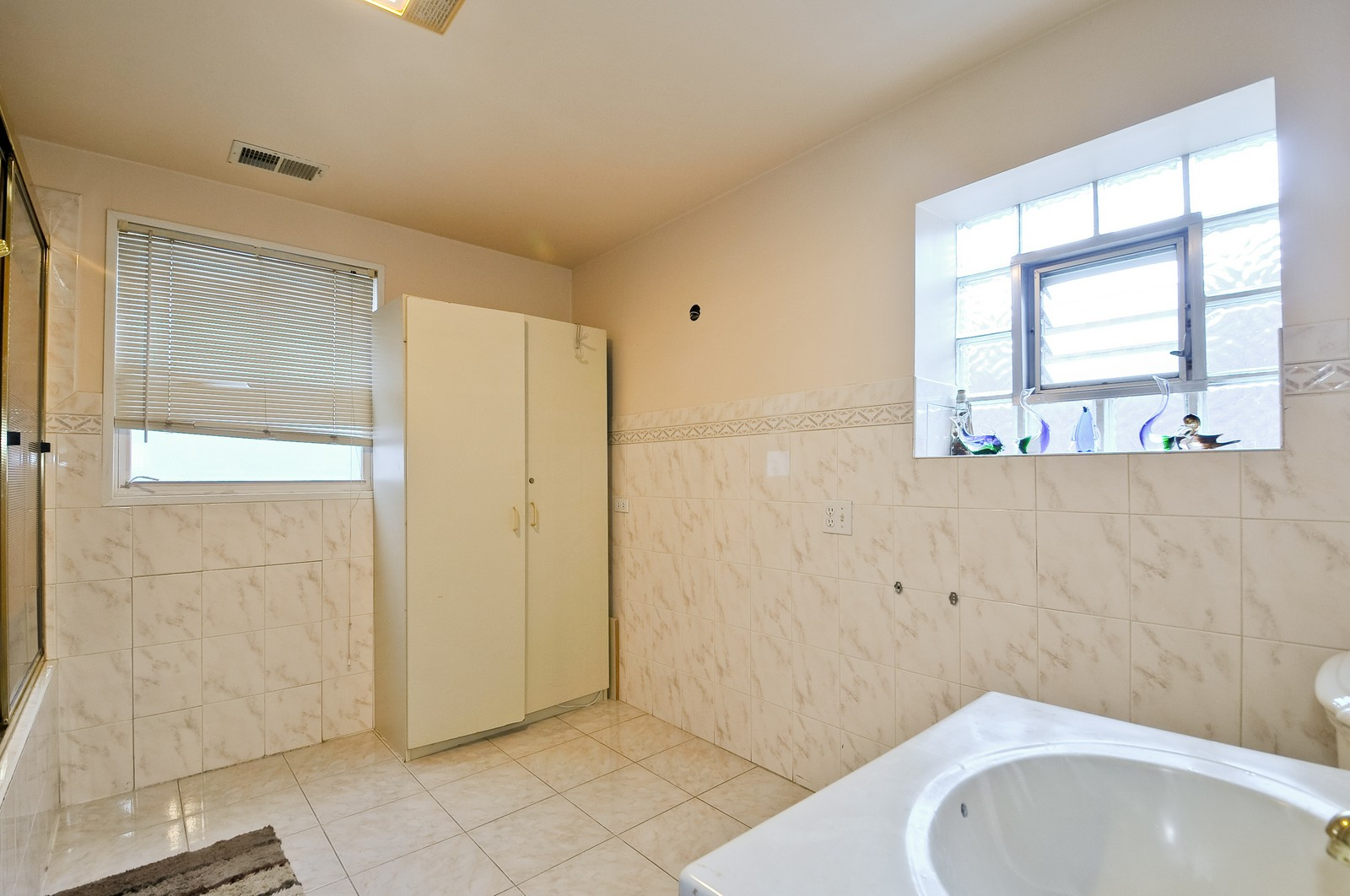 Real Estate Photography - 6605 N Whipple St, Chicago, IL, 60645 - Master Bathroom