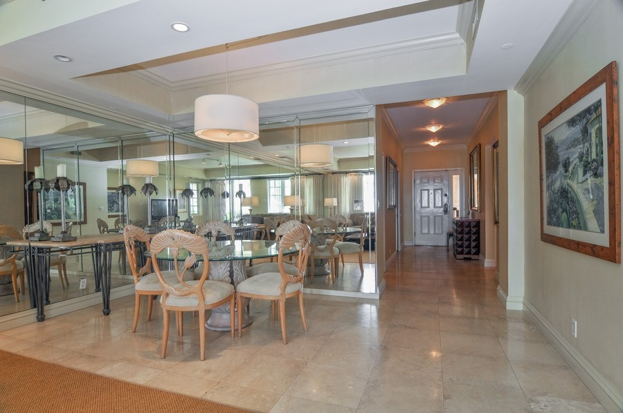 Real Estate Photography - 19213 Fisher Island Drive, Fisher Island, FL, 33109 - Foyer/Dining Room