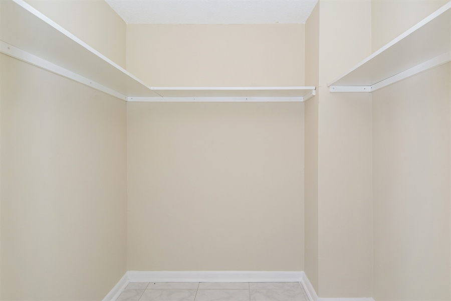 Real Estate Photography - 1825 S Ocean Dr, Unit 404, Hallandale Beach, FL, 33009 - Master Bedroom Closet