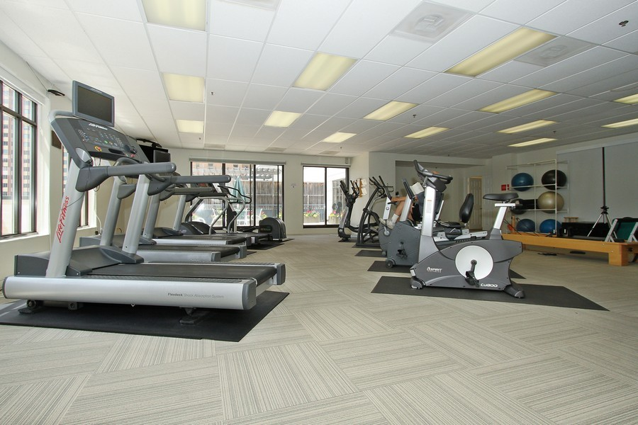 Real Estate Photography - 55 W Delaware Pl, Unit 501, Chicago, IL, 60610 - Fitness Room Cardio Area