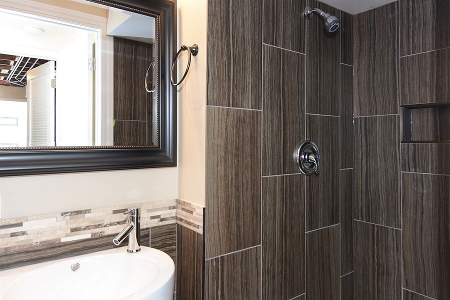 Real Estate Photography - 57 E 161st Pl, South Holland, IL, 60473 - Lower Bathroom View #1
