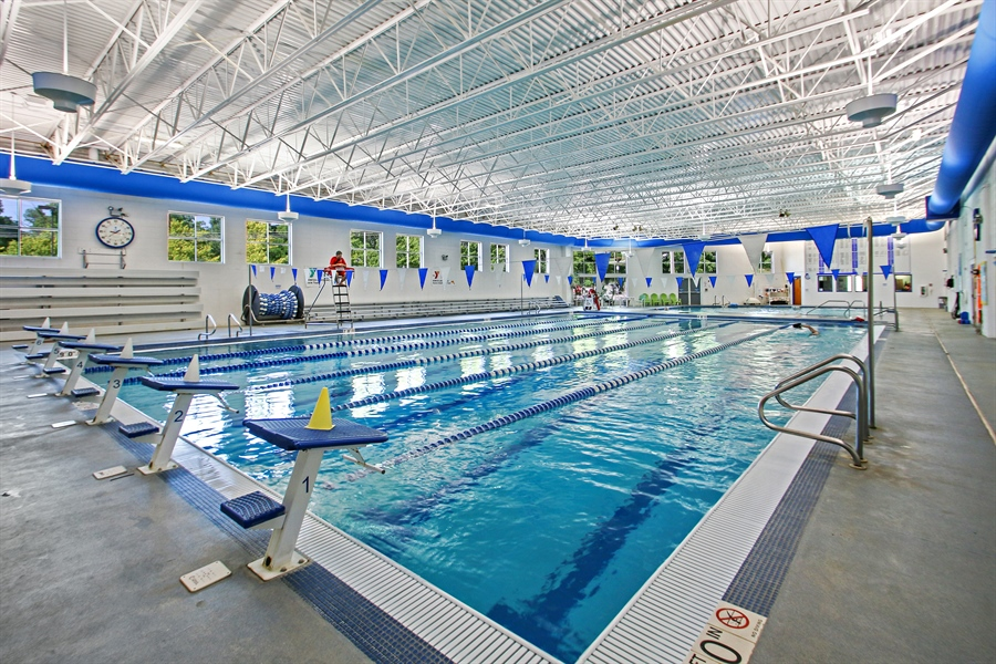 Real Estate Photography - 203 S Wells St, Lake Geneva, WI, 53147 - YMCA Aquatic Center featuring a UV system.