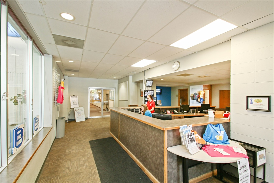 Real Estate Photography - 203 S Wells St, Lake Geneva, WI, 53147 - Our friendly staff will greet you in the lobby.