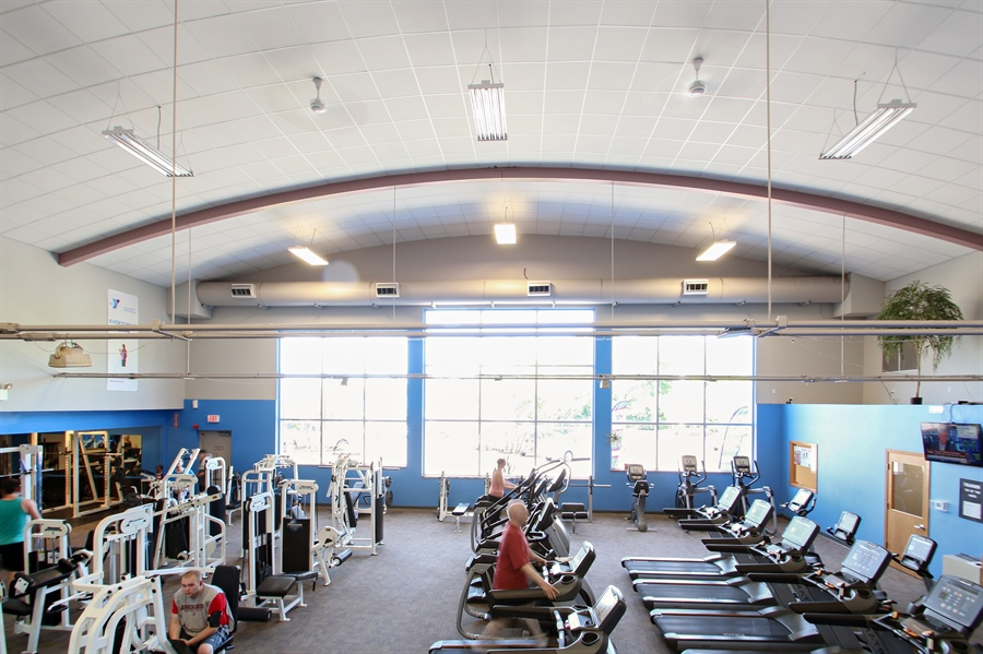Real Estate Photography - 203 S Wells St, Lake Geneva, WI, 53147 - Ample Natural Lighting Enhances Your Workout.